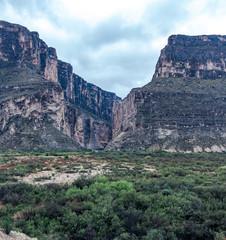 A mountain range split by the Rio Grande River in Texas