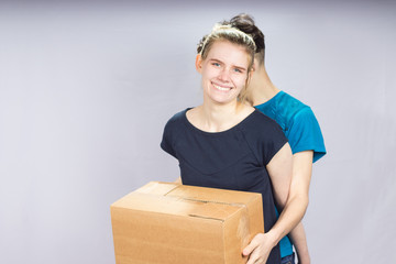 girl gently hugs her friend through the box