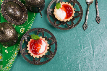Round tartlets with red jam