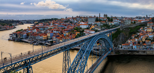 Panoramic view of cityscape of Porto, Portugal over Dom Luis I Bridge and Douro River at sunset