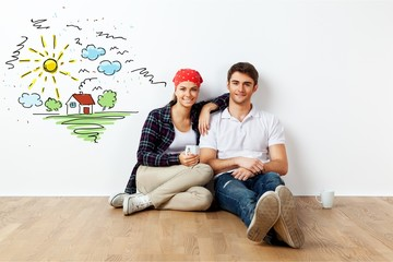 Portrait Of Happy Young Couple Sitting