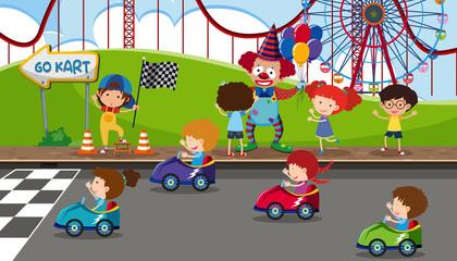 Go kart racing at fun fair