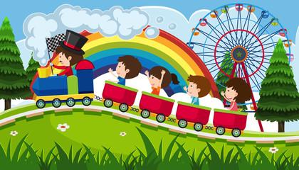 Children riding a train in fun park
