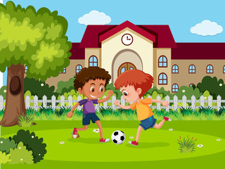 Children play football at school