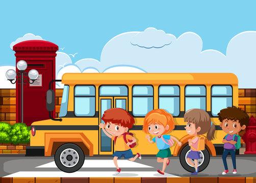 Children running to get on the school bus