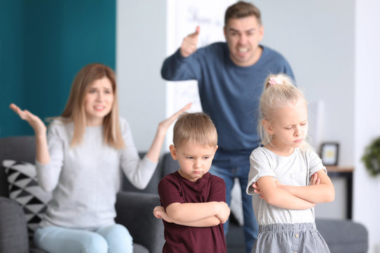 Parents scolding their children at home. Family conflict