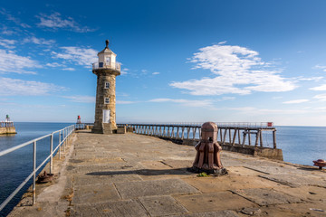 Whitby Lighthouse and historic harbour entrance - North Yorkshire, England