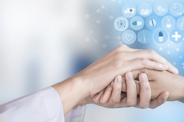 doctor holding patient hand with modern medical technology background