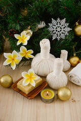 Fotobehang Spa Christmas spa with Composition of spa treatment and wooden background