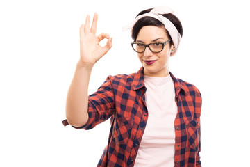 Pretty pin-up girl wearing glasses showing ok gesture.