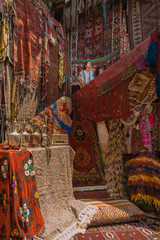young woman at an old traditional Turkish carpet shop in cave house Cappadocia, Turkey Kapadokya, young woman on vacation in Turkey