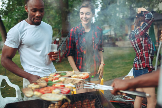Group of friends making barbecue in the backyard. concept about good and positive mood with friends