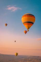 hot air balloons during snrise Cappadocia Kapadokya Turkey, Fairytale landscape hills