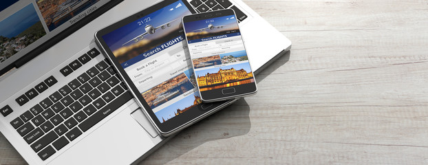 Smartphone and tablet on a computer keyboard, Search flights on the screens, wooden background, copy space. 3d illustration