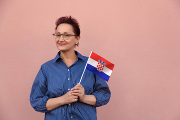 Croatia flag. Woman holding Croatian flag. Nice portrait of middle aged lady 40 50 years old with a national flag isolated on white background.Learn Croatian language. Visit Croatia concept.