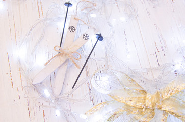 Christmas or New Year background: , glittering stars on white wood, top view, copy space.