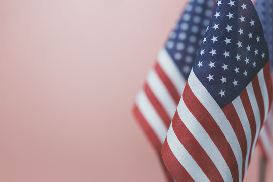 Flags United States of America with vintage pink background empty space for your text on left.