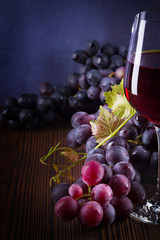 Glass with red wine and grapes
