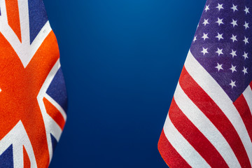 Flags United State of America and Great Britain with blue background. Concept of international relations.