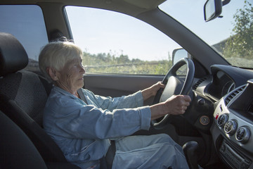 an elderly woman driving