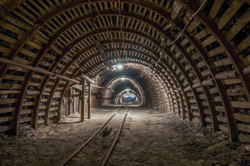 Tunnel in the mine, track, light in the end