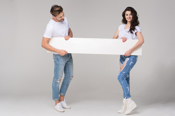Happy summer couple with white board