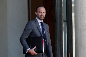 French Prime Minister Edouard Philippe leaves after the weekly cabinet meeting at the Elysee Palace in Paris