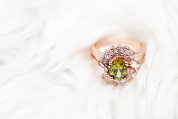 Green gem stone and diamond on pink gold ring
