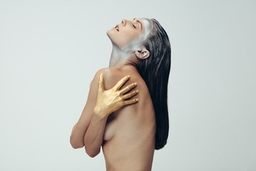 Sensual woman with silver and gold body paint