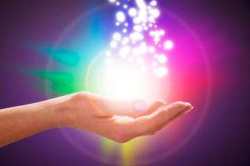 Person's Hand Into Magical Healing Energy Field