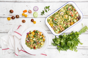 Couscous salad with tomatoes, cucumber, parsley and mint