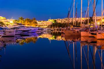Romantic scene with traditional boats in Porto Cristo - Cala D`or region of Palma de Mallorca