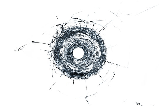 Broken glass single bullet hole in glass isolated on white