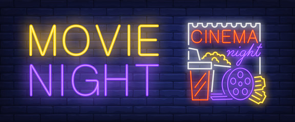 Movie, cinema night neon style banner. Text, popcorn, film reel, clapper board on brick background. Night bright advertisement. Can be used for signs, posters, billboards