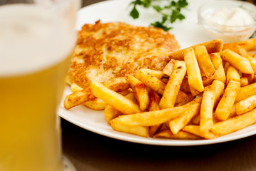 Vienna schnitzel and French fries. Traditional Austrian dish.