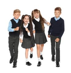 Little children in stylish school uniform on white background