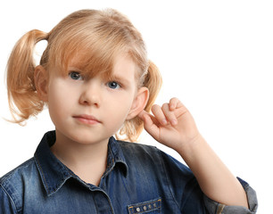 Cute little girl with hearing problem on white background