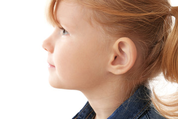 Cute little girl on white background. Hearing problem