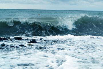 blue ocean wavebreaks along the shore