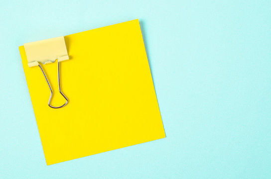 yellow binder clips and yellow sticky notes.