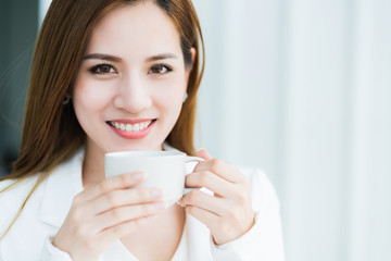 smart and attractive charming business asian woman ready to work with energy and happiness morning light on office