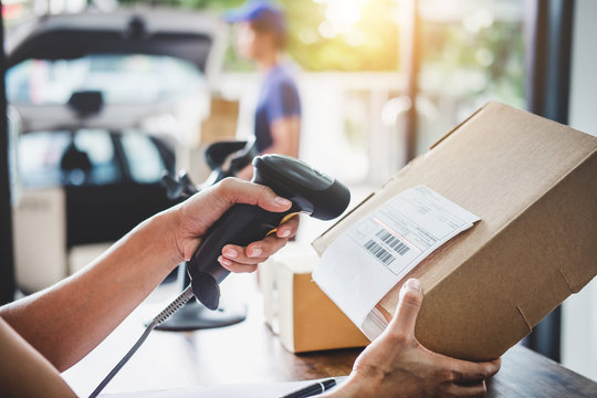 Home delivery service and working service mind, Woman working barcode scan to confirm sending customer in post office