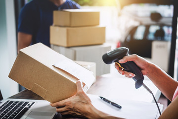 Home delivery service and working service mind, Woman working barcode scan to confirm sending customer in post office Fototapete