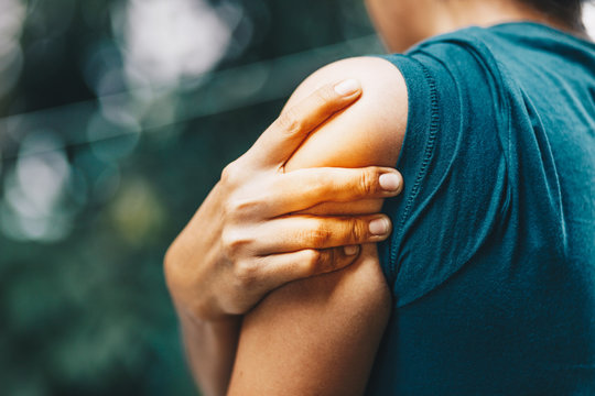 woman having pain in shoulder , health care concept