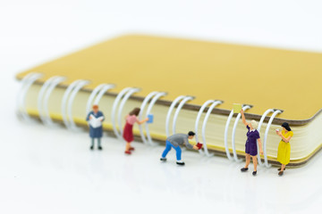 Miniature people: Student reading book with big book, library. Image use for education concept.