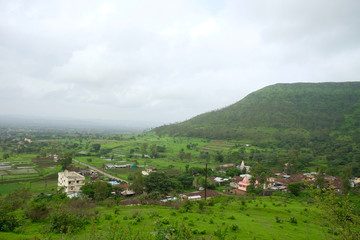 Lush green monsoon nature landscape mountains, hills, Purandar, Maharashtra, India