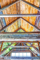 Vibrant colorful wooden interior of old, abandoned house with window triangles