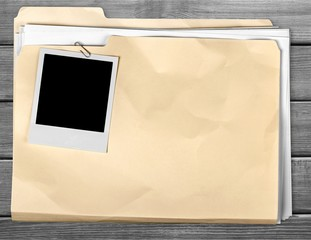 File Folder with Documents and Blank Polaroid