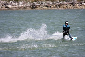 kitesurfer riding his board