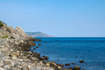 Beautiful rock off the coast of the sea. Turquoise water, blue sky, incredible landscape.